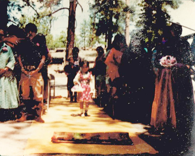 My father and mothers traditional ceremony. At age 5, I was the flower girl